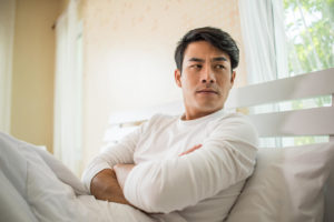 Man thinking about Erectile Dysfunction treatment and issues