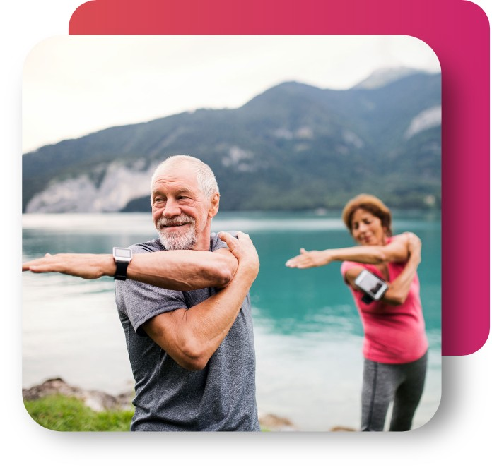 elderly-couple-stretching-by-lake
